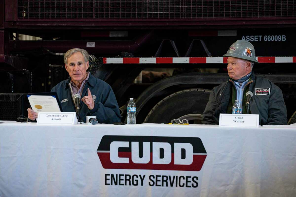 Texas Governor Greg Abbott prepares to sign an executive order during a round table discussion at Cudd Energy Services, Thursday, Jan. 28, 2021, in Odessa, Texas. Governor Abbott took part in a round table with oil and gas workers, energy leaders and other industry advocates to discuss how Texas can continue to support the oil and gas industry nearly a year after the outbreak of COVID-19. (Eli Hartman/Odessa American via AP)