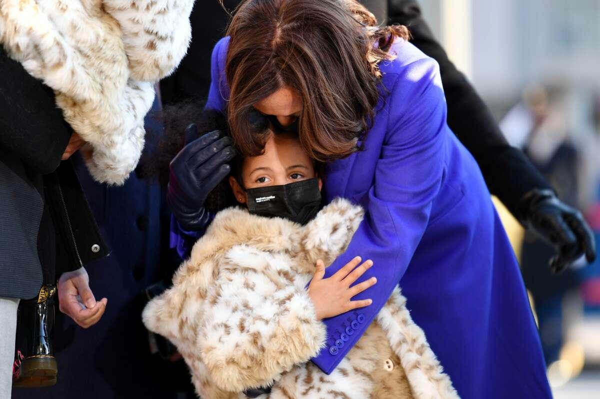 Vice President Kamala Harris walks the abbreviated parade route with her great-niece Amara after U.S. President Joe Biden's inauguration on Jan. 20, 2021, in Washington, D.C.