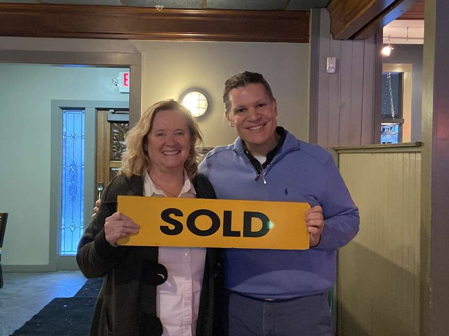 Century 21 Boardwalk Realtor Gini Pelton and restaurant owner Ted Fricano celebrate the sale of 440 River St. Photo: Erin Glynn/News Advocate
