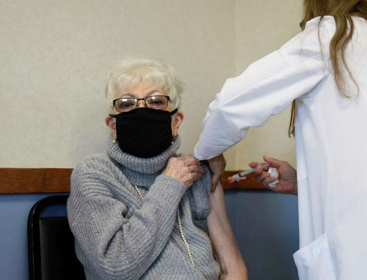 Stamford resident Amelia Hanzlik receives her COVID-19 vaccine from Celmira Guzman, an RN with the Town of Greenwich, at the COVID-19 vaccination clinic at Town Hall last Thursday. Clinics are once again open after this week's snowstorm.