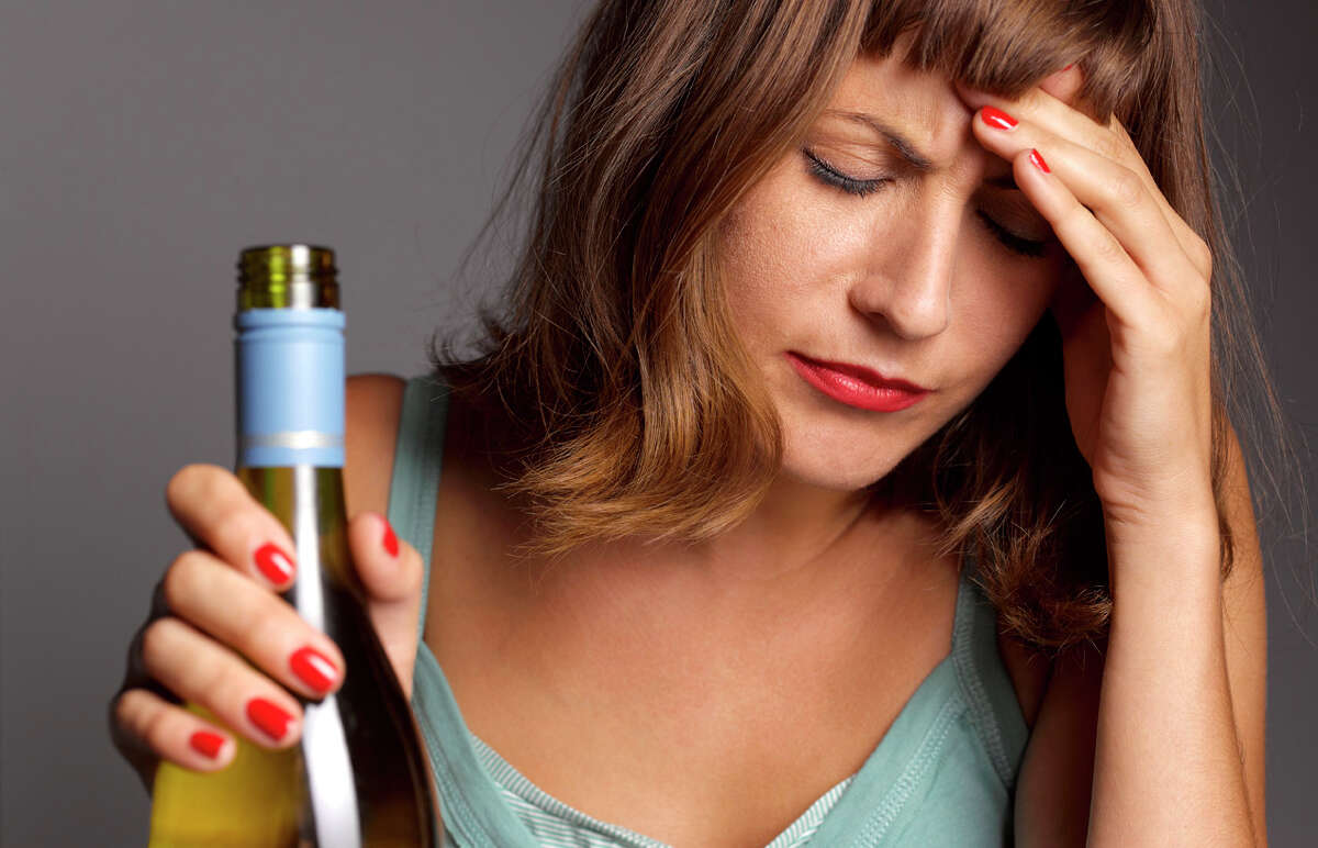 A woman acted inappropriately at a social gathering because she was drunk.