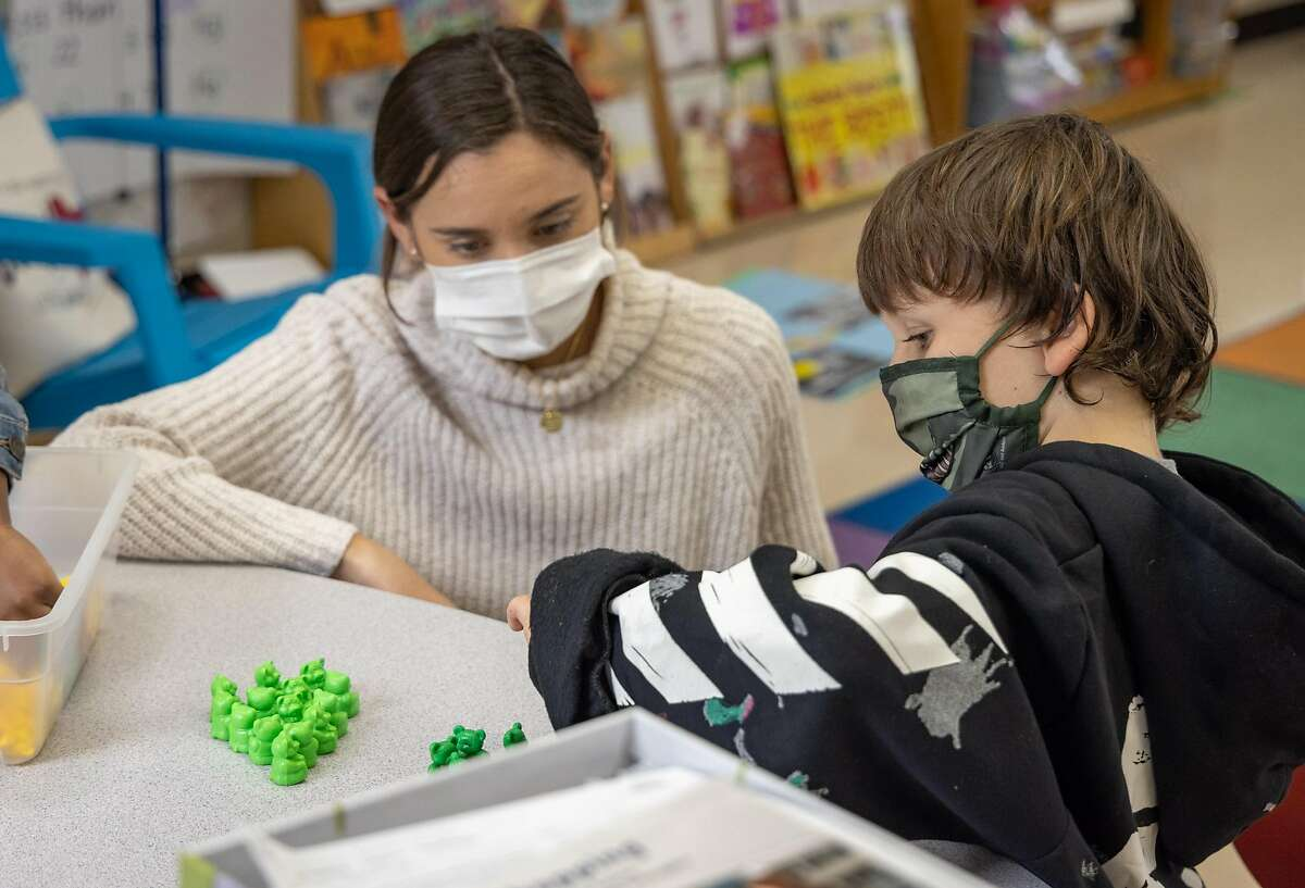 Teacher Samantha Kelly helps Angelo Nuno in her 1st grade class. Students at the MLK Bayside school attend 1st grade in Sausalito, Calif. on January 28th, 2021