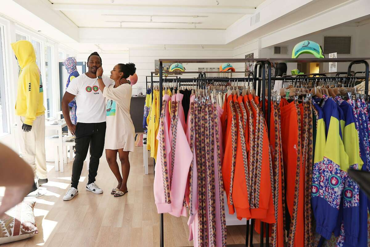 Yema Khalif (left) and Hawi Awash prepare for a Chamber of Commerce video at their Tiburon boutique, Yema.