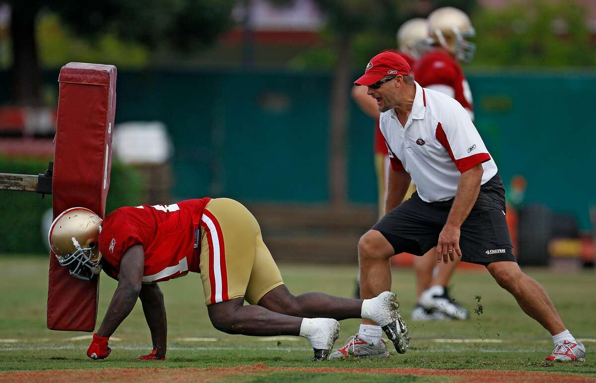 49er running back coach Tom Rathman works on blocking drills during the San Francisco 49ers during summer camp held at the 49ers headquarters in Santa Clara, Calif., on August 6, 2009.