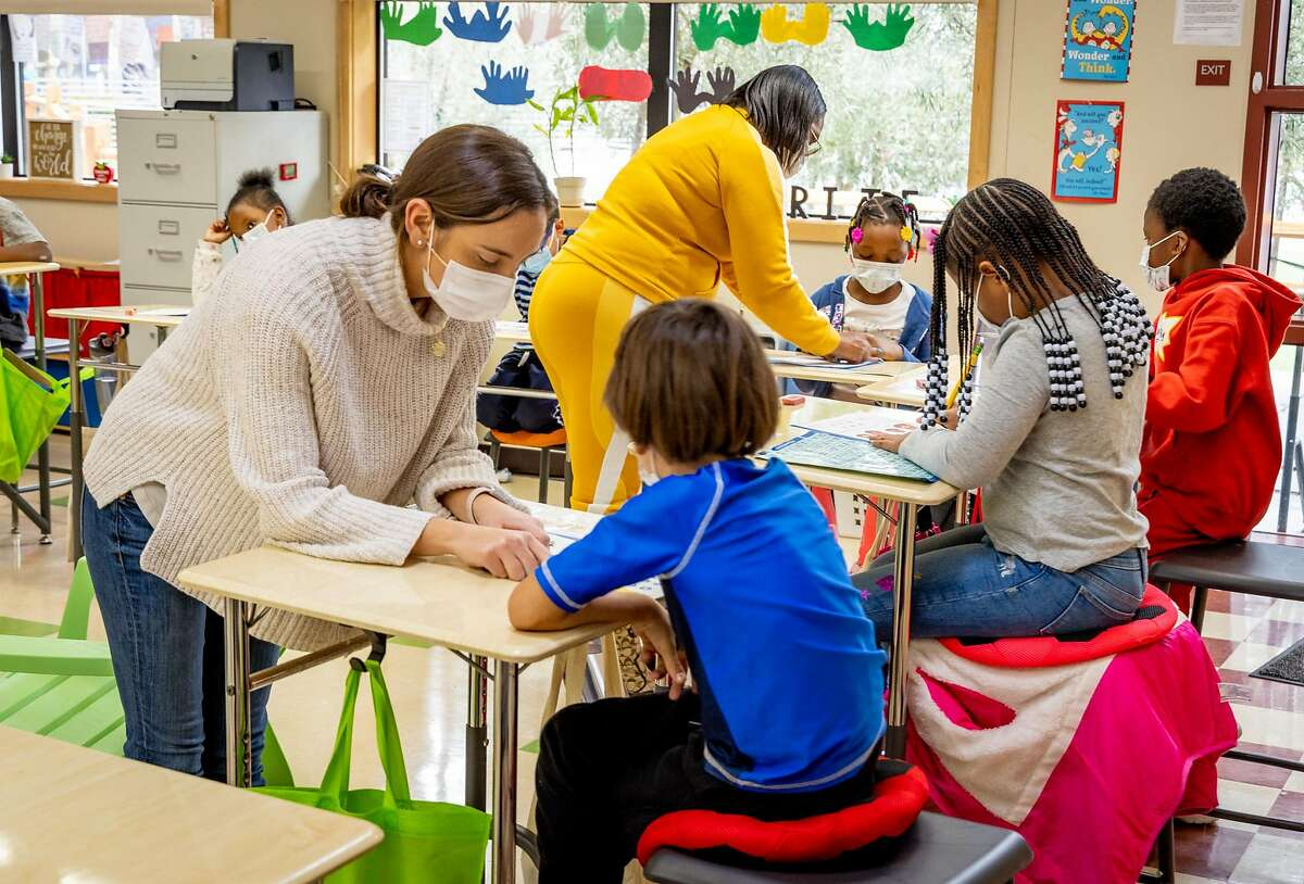 Teacher Samantha Kelly helps Jack Knight in her 1st grade class. Students at the MLK Bayside school attend 1st grade in Sausalito, Calif. on January 28th, 2021