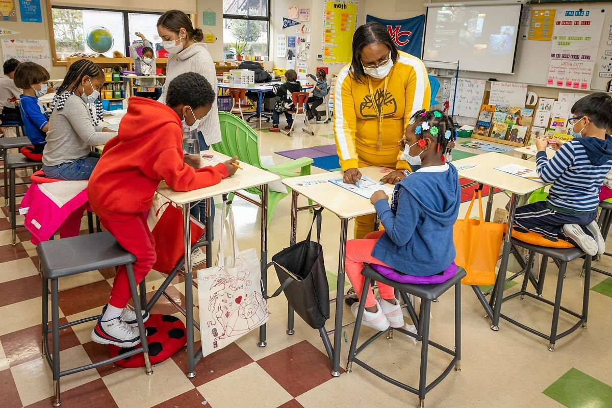Teachers work with first-graders at Bayside Martin Luther King Jr. Academy, a public school in Sausalito, which has been open for in-person learning since September.