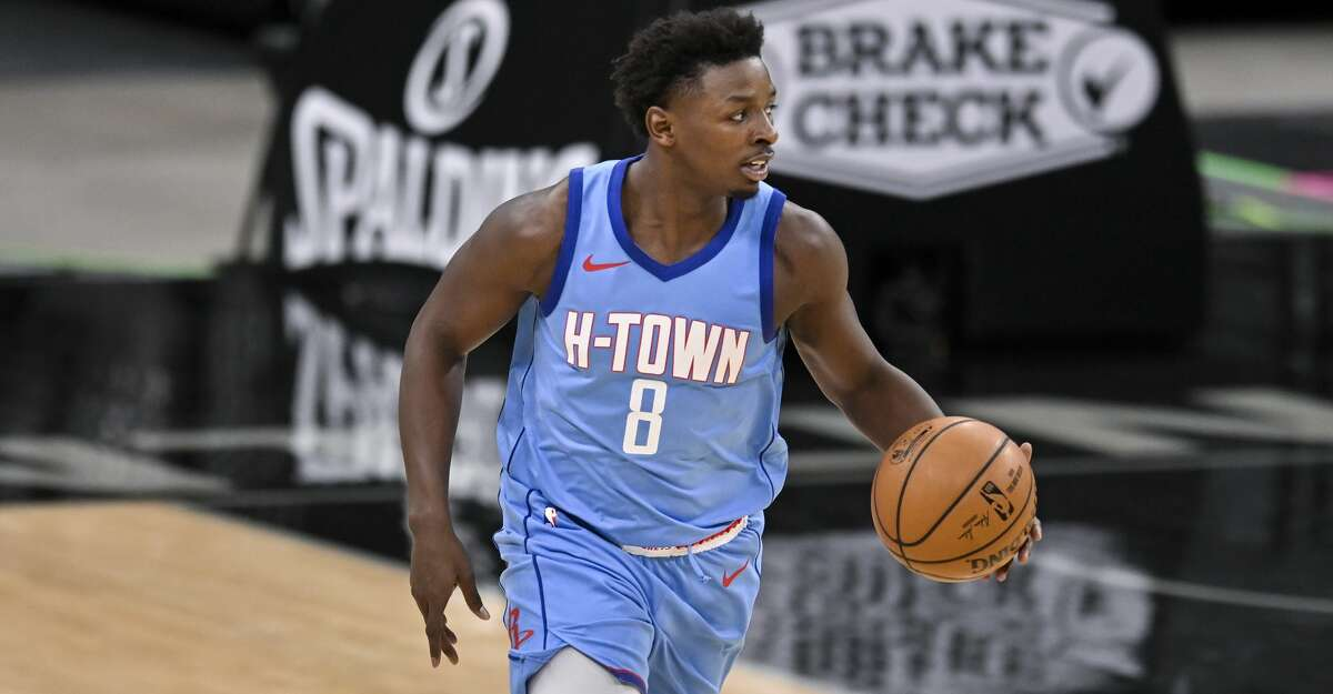 Houston Rockets' Jae'Sean Tate runs up the court during the second half of an NBA basketball game against the San Antonio Spurs, Saturday, Jan. 16, 2021, in San Antonio. San Antonio won 103-91. (AP Photo/Darren Abate)