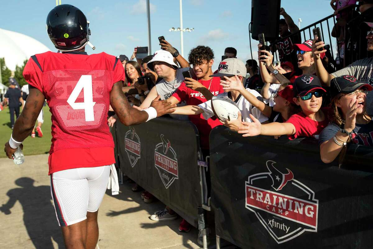 Texans fans, cheering Deshaun Watson at training camp in 2019, don't want to see the quarterback leave but understand his situation.