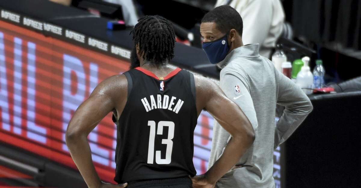 Houston Rockets head coach Stephen Silas, right, speaks with Houston Rockets guard James Harden, right, during the first half of an NBA basketball game against the Portland Trail Blazers in Portland, Ore., Saturday, Dec. 26, 2020. (AP Photo/Steve Dykes)