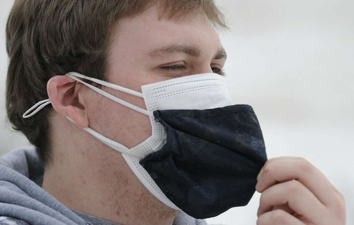 Mark Holton wears two masks in Wyoming County, Pa.
