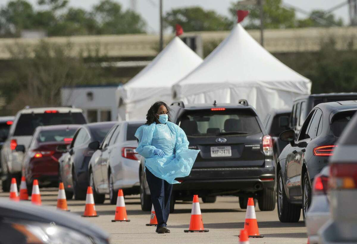 Motorists wait in line at the drive-thru COVID-19 vaccine site at Delmar Stadium on Wednesday.