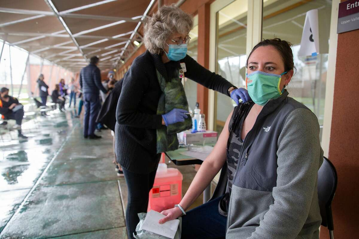 Jaclyn Imrie, a fifth grade teacher at St. Helena Elementary, receives her first coronavirus vaccination at the St. Helena Foundation vaccination clinic at Napa Valley College in St. Helena earlier in January. The clinic has run out of coronavirus vaccine.
