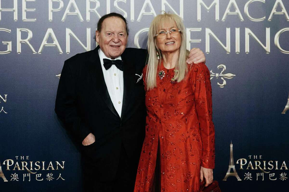 Billionaire Sheldon Adelson, chairman and chief executive officer of Las Vegas Sands Corp., left, and his wife Miriam Adelson pose for a photograph on the red carpet prior to the opening ceremony of the Parisian Macao casino resort, operated by Sands China Ltd., a unit of Las Vegas Sands Corp., in Macau, China, on Tuesday, Sept. 13, 2016.