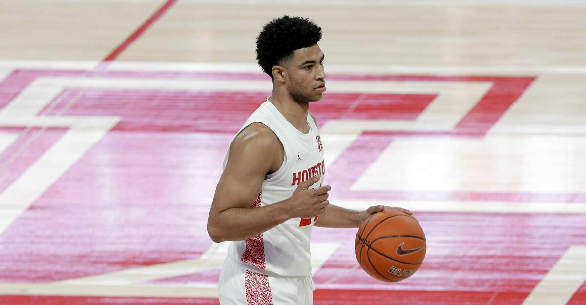 Houston guard Quentin Grimes (24) during the first half of an NCAA college basketball game against Central Florida Sunday, Jan. 17, 2021, in Houston. (AP Photo/Michael Wyke)