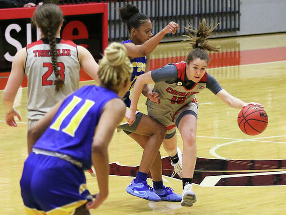 SIUE freshman Sara Majorosova (right) handles the ball against defensive pressure from Morehead State during a Jan. 16 game at First Community Arena in Edwardsville. The Cougars played on the road Thursday against Southeast Missouri in Cape Girardeau, Mo. Photo: Greg Shashack | The Telegraph