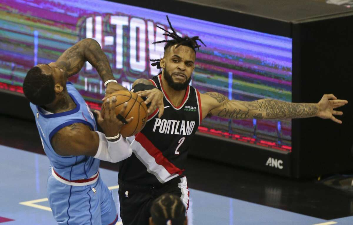 Portland Trail Blazers guard Gary Trent Jr. (2) fouls on Houston Rockets guard John Wall (1) during the second quarter of the NBA game Thursday, Jan. 28, 2021, at Toyota Center in Houston.