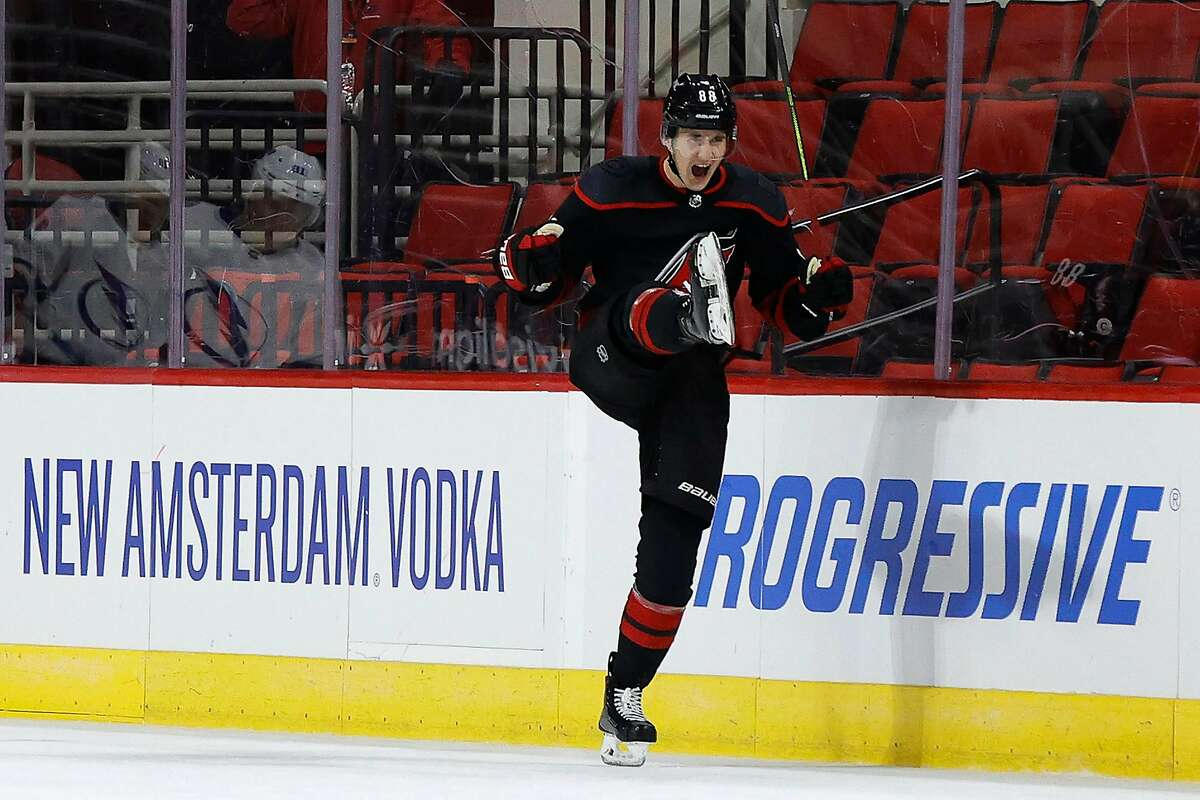 Martin Necas celebrates after scoring in overtime to give Carolina a win over Tampa Bay.