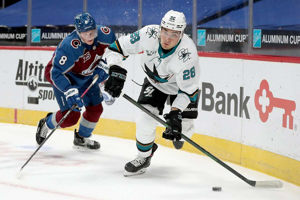 Sharks forward Timo Meier brings the puck off the boards while trying to stay ahead of Colorado's Cale Makar in the first period,