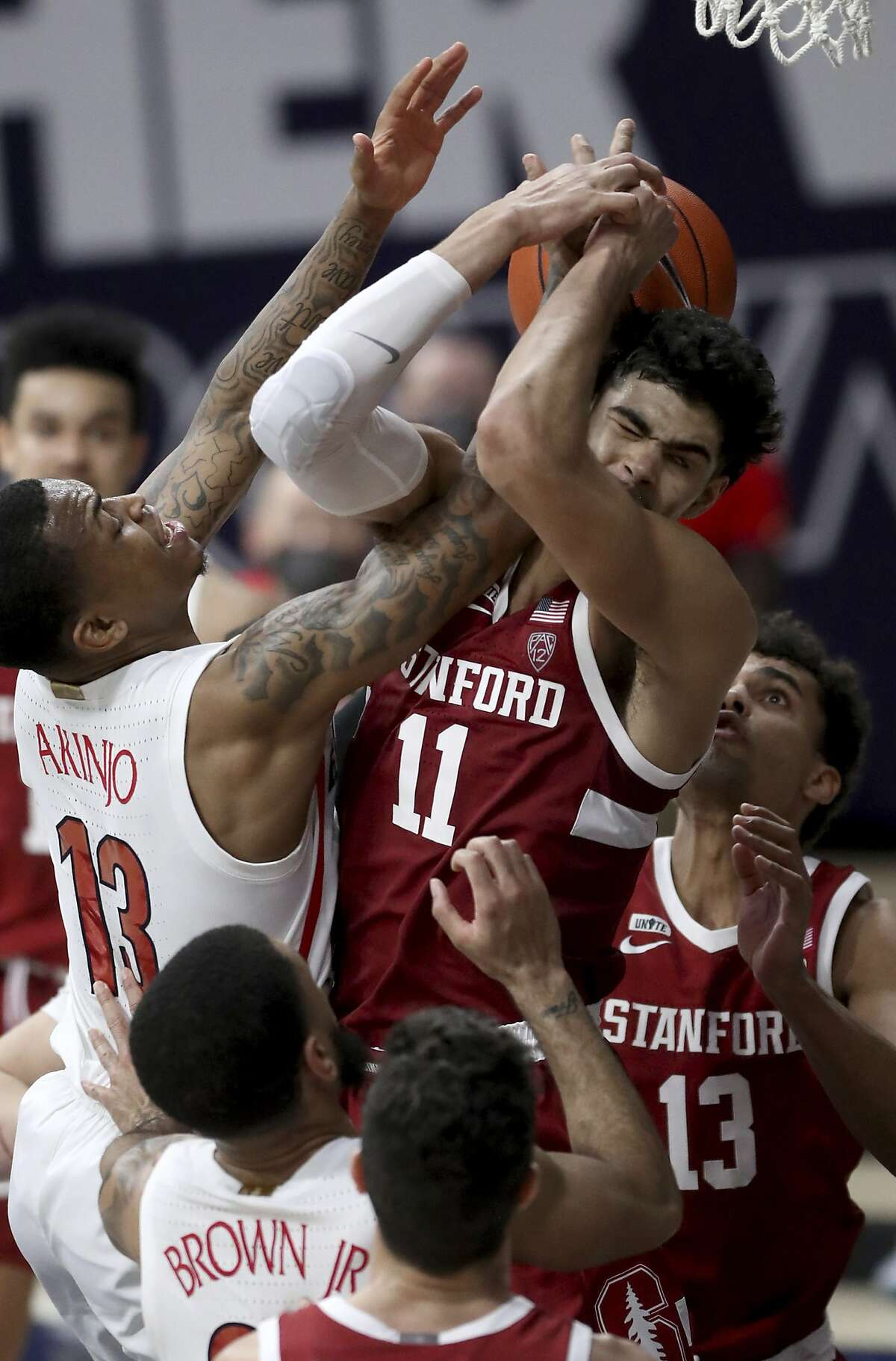 Stanford forward Jaiden Delaire finds Arizona guard James Akinjo to be a real handful Thursday.