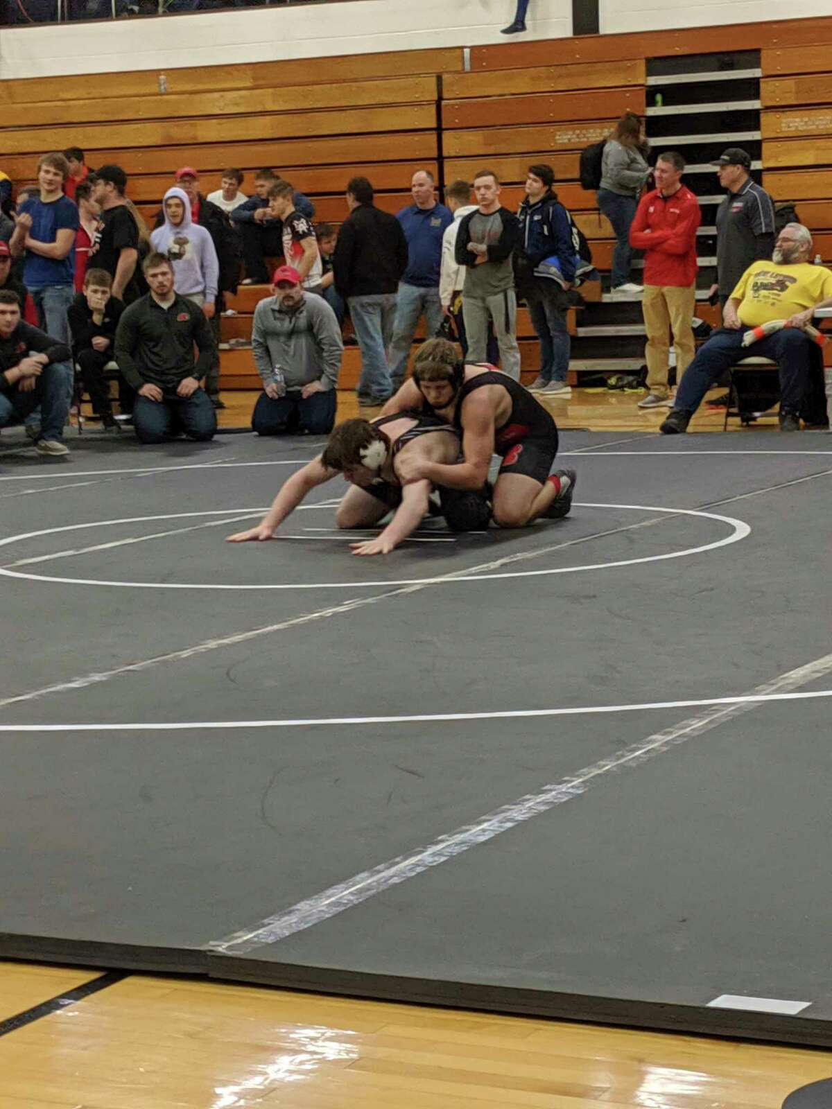 Pictured is Jake Fischer at districts last year. This win allowed the then Beaverton High School Junior to place third at districts and advance to regionals. He was hoping to earn 100 career wresting wins by Jan. 1, but that dream is dwindling as the indoor contact sport ban continues. (Photo Provided)