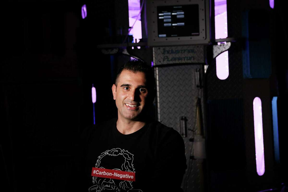 Houston-based Cemvita Factory co-founder and CEO Moji Karimi in front of the company's photobioreactor on Tuesday, Jan. 26, 2021. Karimi hopes his company will win the $100 million funding being offered by Elon Musk to the company with the best carbon capture technology.
