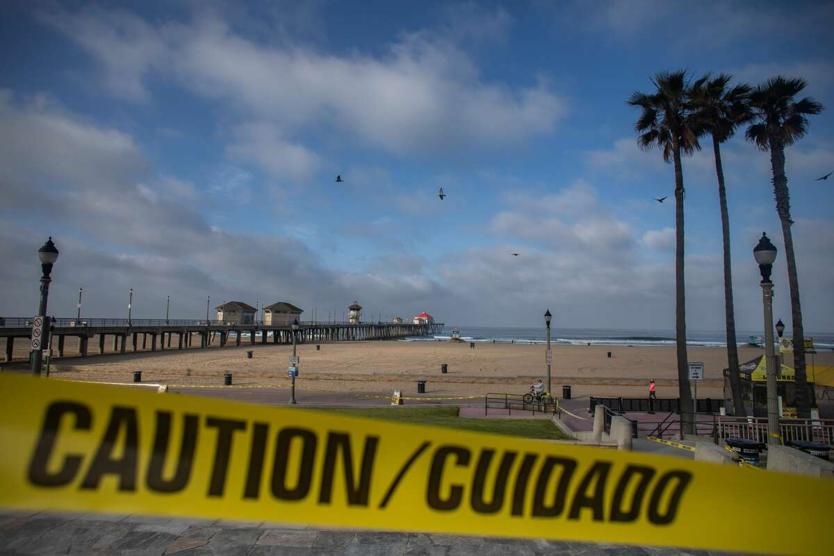 Huntington Beach, California is virtually empty on May 02, 2020. - Orange County beaches will remain closed after a California Superior Court judge rejected a request May 1 to block California Governor Gavin Newsom's order to close local beaches during the coronavirus pandemic. (Photo by Apu GOMES / AFP) (Photo by APU GOMES/AFP via Getty Images)