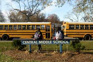 Students wait to be picked up at dismissal at Central Middle School in Greenwich, Conn. Thursday, Nov. 21, 2019.