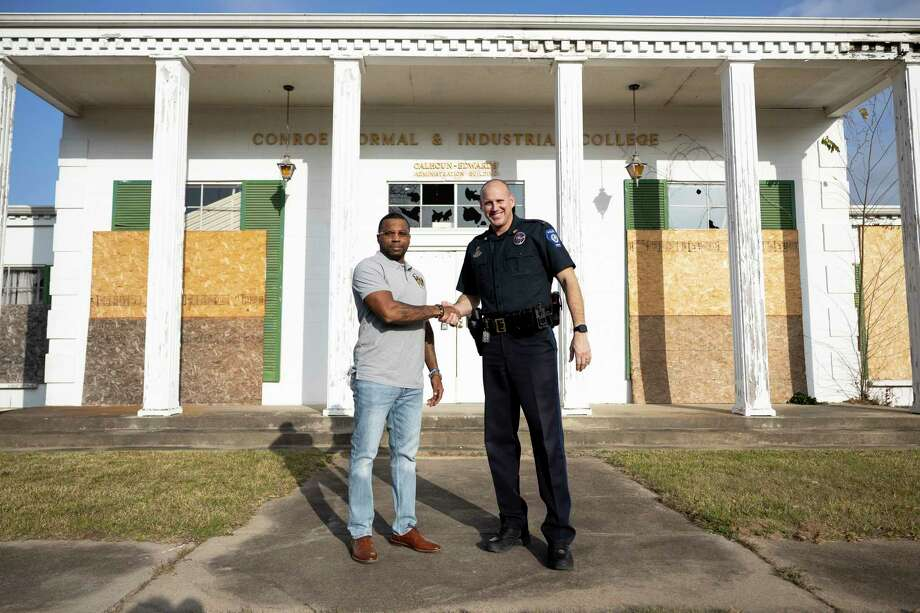 Conroe Police Lt. Brent Stowe, left and LaDon Johnson, shake hands in front of the old Conroe Normal & Industrial College, Tuesday, Jan. 26, 2021, in Conroe. Stowe and Johnson want to restore the one-time school for Black students and turn it into a facility to help at-risk male youth in the area. Photo: Gustavo Huerta, Houston Chronicle / Staff Photographer / Houston Chronicle © 2021