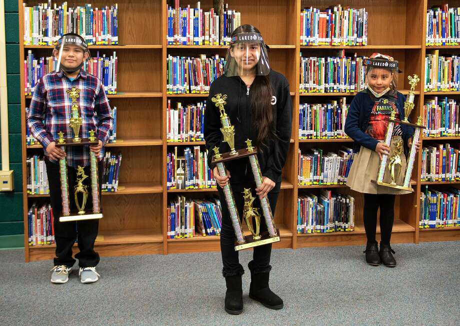 LISD's virtual Spelling Bee was won by Lamar Middle School eighth grader Mia Cuevas, center, who won for the fourth straight year. Others finishing in the top three included second-place Alfredo Vasquez of K. Tarver Elementary School, left, and third-place Victoria Salazar of Lamar Middle School, right. Photo: Danny Zaragoza / Laredo Morning Times