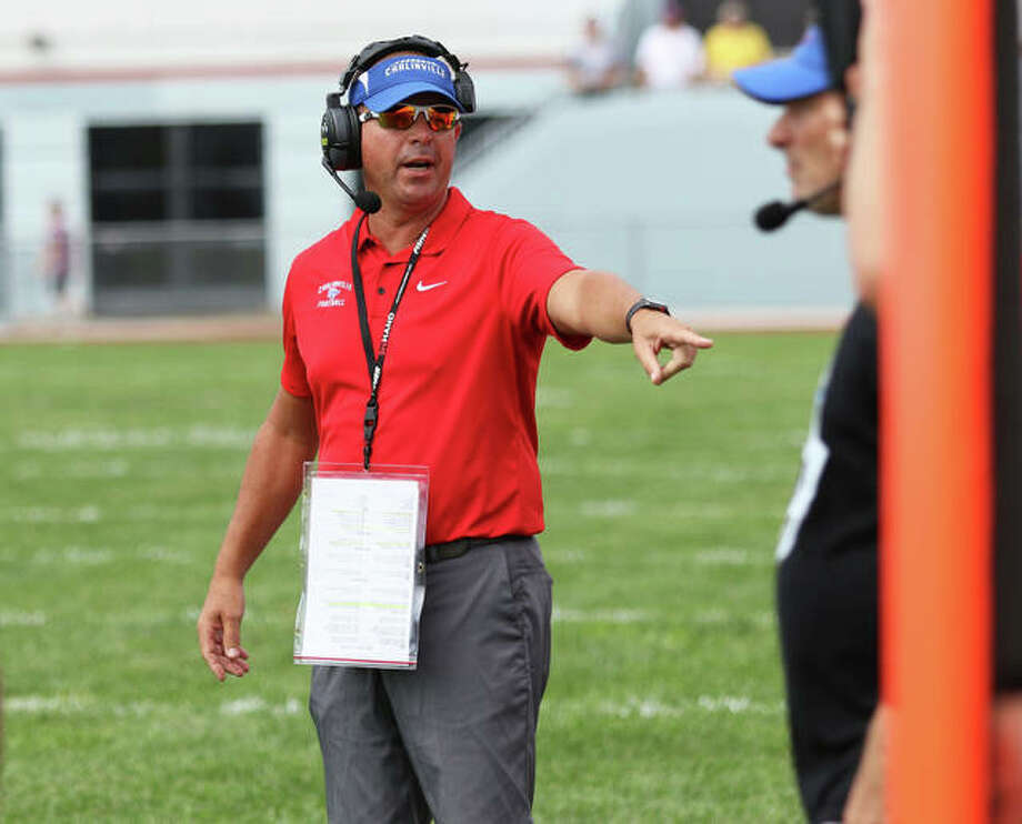 Carlinville coach Chad Easterday (left) directs his team from the sideline during a Week 1 game at Roxana in 2019. Easterday, long stuck on 99 career victories, welcomes the six-game season the IHSA will conduct starting in March. Photo: Greg Shashack / The Telegraph