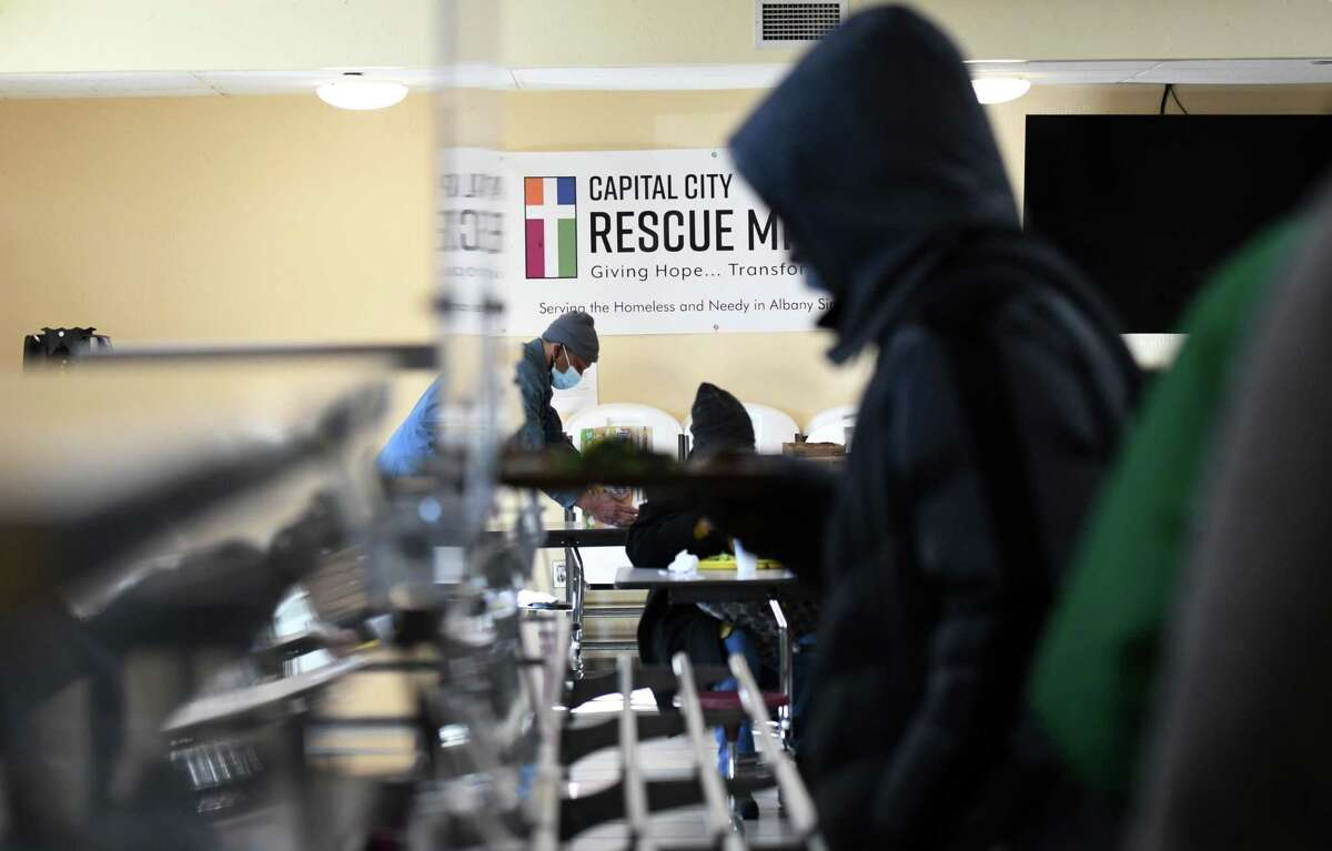 Lunch is served for the those in need at Capital City Rescue Mission on Friday, Jan. 29, 2021, in Albany, N.Y. (Will Waldron/Times Union)