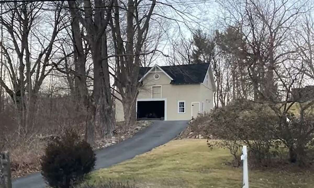 The 1830s barn located at 49 Daniels Farm Road could be converted into 2 single-bedroom apartments.