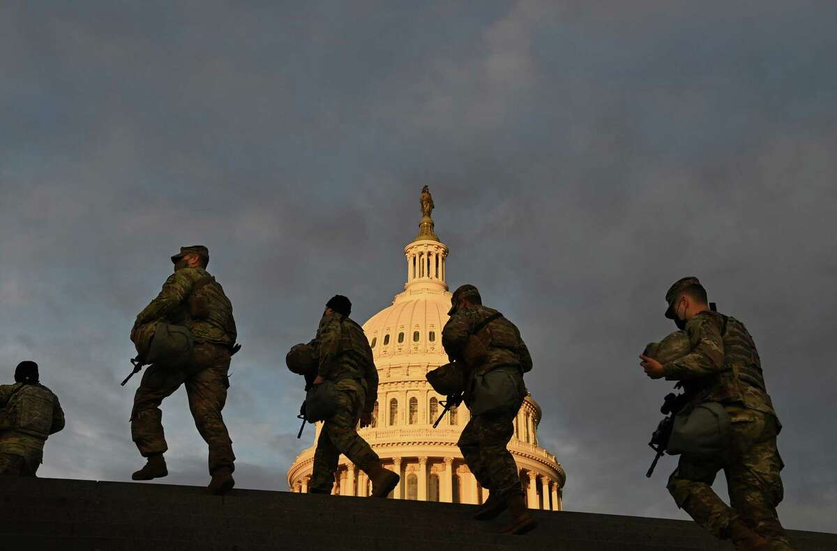 Members of the National Guard outside the U.S. Capitol at sunrise on Jan. 19, 2021.