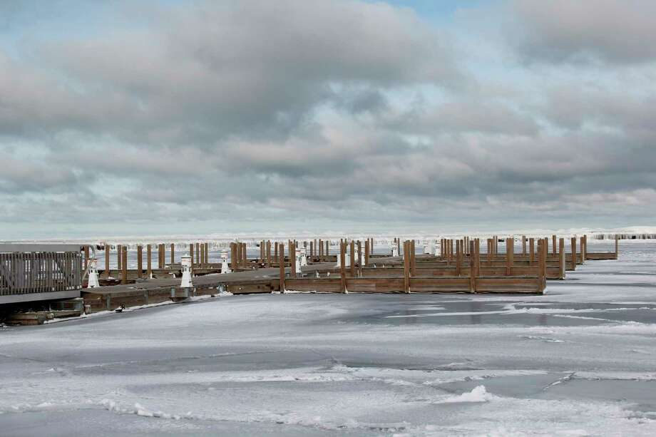 Some of the docks in the now-frozen Port Austin State Harbor. The DNR plans on having repairs to the harbor done in time for use this coming spring. (Robert Creenan/Huron Daily Tribune)