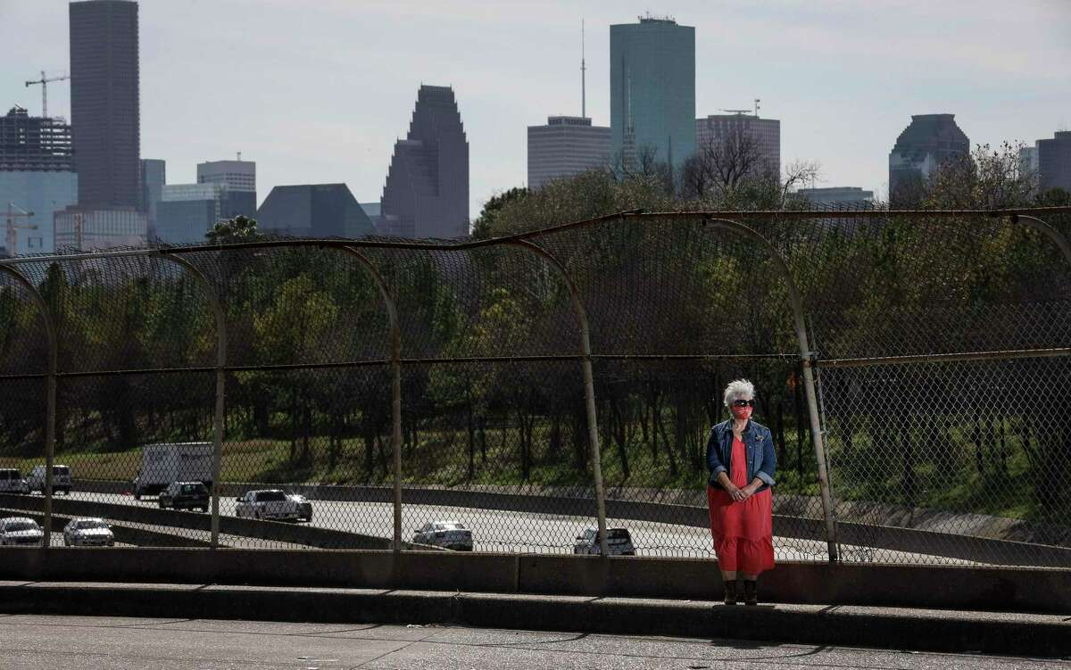 Susan Graham, co-founder of Stop-TxDOT I-45, poses for a portrait Jan. 27, 2021, on the North Main Street bridge over Interstate 45 in Houston.
