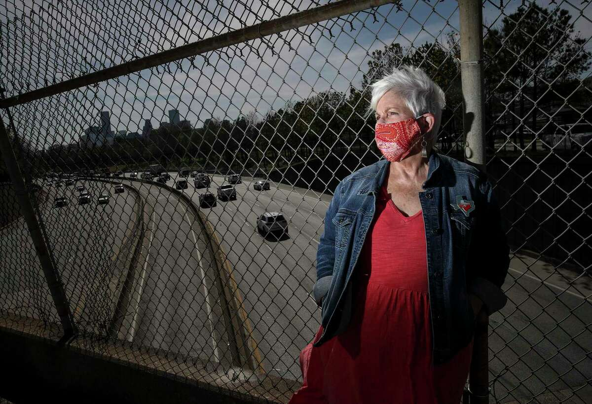 Susan Graham, co-founder of Stop-TxDOT I-45, stands above Interstate 45 on the North Main Street bridge in Houston on Jan. 27, 2021. The group has opposed efforts to widen the freeway, calling them out of step with the region's mobility needs and disruptive to neighborhoods.