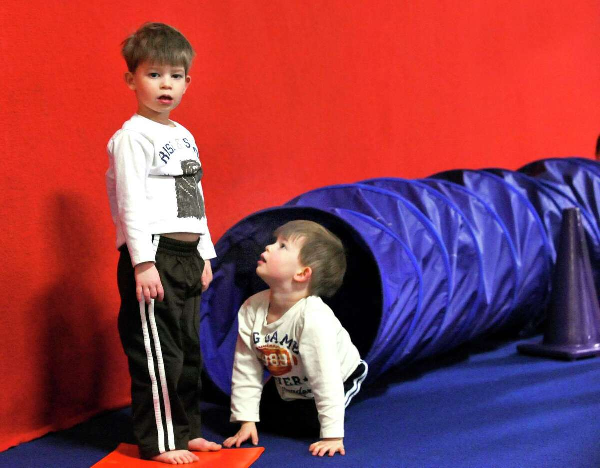Nicholas Miller looks up to his brother, Caleb Miller, both 3, of Ridgefield, as Caleb looks toward their mom during Tumble Bear class at the Gymnastic Spectrum in Danbury, during a previous year. Boys, and girls are invited to sign up for FLIPS Tumbling classes at the Ridgefield Recreation Center starting March 1. Led by former Walt Disney World stuntman Phil Fotopoulos, this program is great for cheerleaders, gymnasts and break dancers. Students, in kindergarten through the fifth grade, meet on Mondays from 4:30 p.m to 5:30 p.m. Students, in the fourth through the 12th grade, meet on the Mondays from 5:45 p.m. to 6:45 p.m. Groups will be divided according to age and skill level.