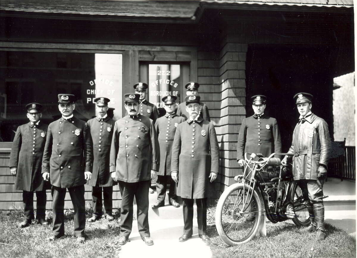 The Greenwich Police Department in 1910 included a motorcycle cop.