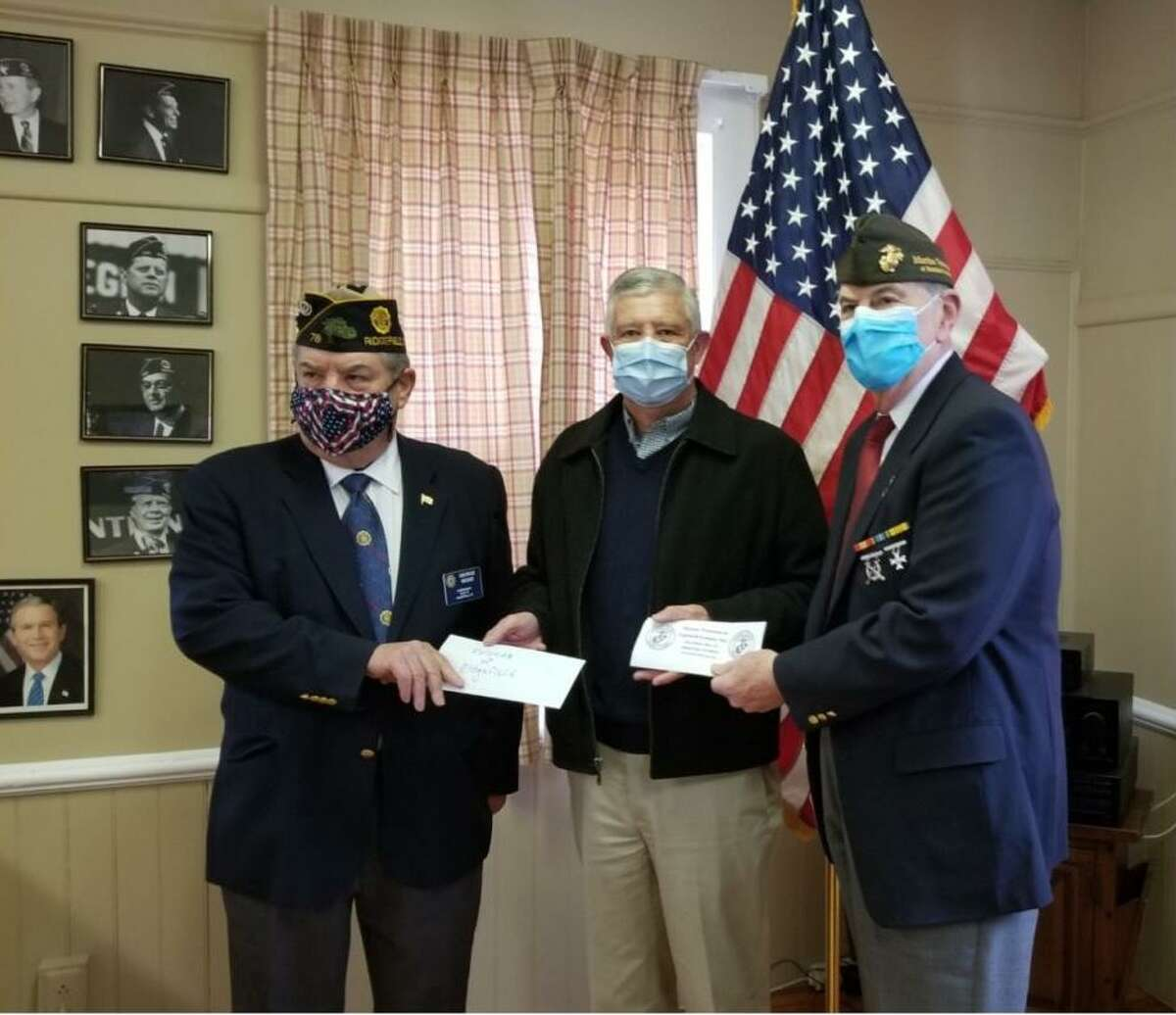 George Besse of the Ridgefield American Legion and Dick Tiani of the Marine Veterans of Fairfield County recently presented $1,000 donation checks for the New Fund to Ridgefield Selectman Bob Hebert at the American Legion Post 78.