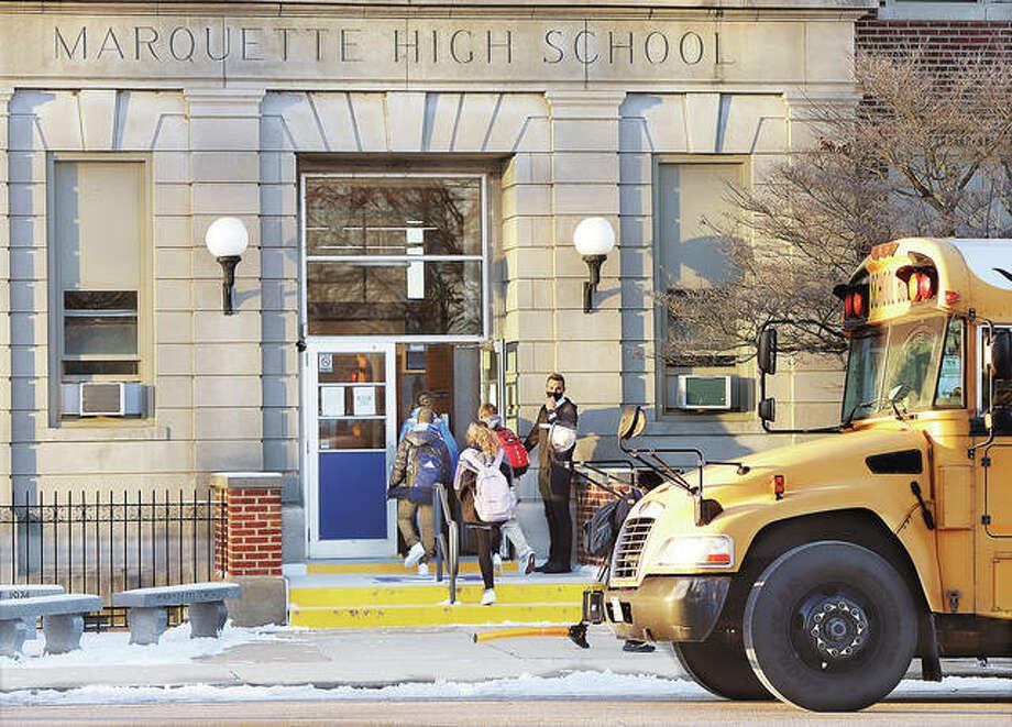 Students head into Marquette Catholic High School on East 4th Street in Alton Friday. Catholic Schools Week kicks off Sunday.