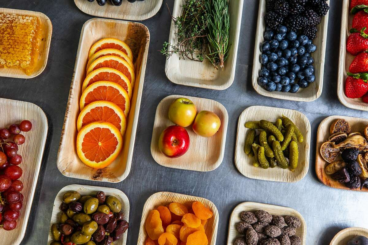 Ingredients for a charcuterie grazing board from Affinage Boards wait to be plated in S.F.