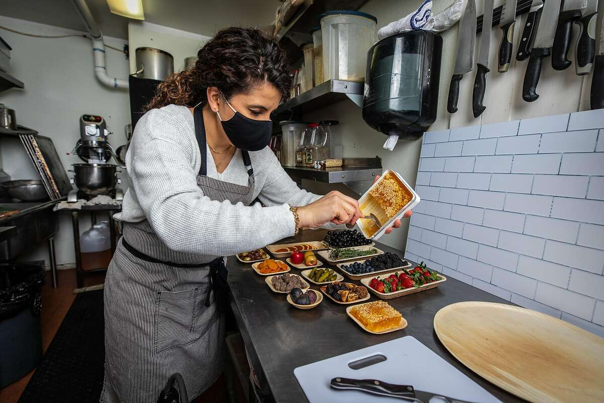 Dina Bshara readies ingredients for her company, Affinage Boards, which makes charcuterie, or grazing boards.