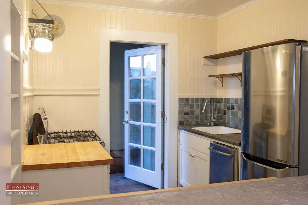 The kitchen has stainless steel appliances, a new gas stove, refrigerator and dishwasher.