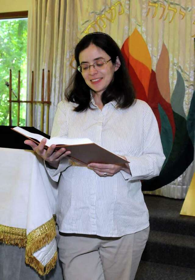 Rabbi Nelly Altenburger of Danbury looks through the new prayer book that will be used for the high holy days at the Congregation B'Nai Isreal on Clapboard Ridge in Danbury on Monday Sept. 6, 2010. Photo: Lisa Weir / The News-Times Freelance