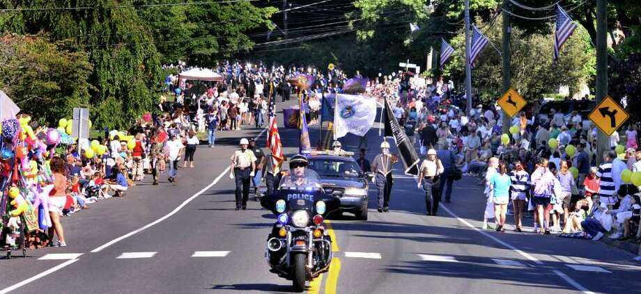 The Newtown Police Department leads the start of the 49th Newtown Labor Day Parade on Monday, Sept. 6, 2010. Photo: Michael Duffy / The News-Times