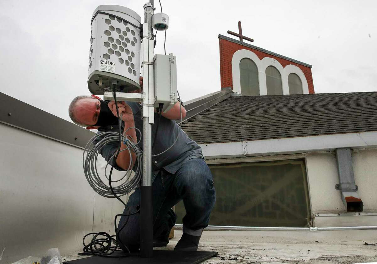 Corey Williams, research and policy director for Air Alliance Houston, installs an air monitor Monday, Jan. 25, 2021, at San Pedro Episcopal Church in Pasadena. WIlliams said that TCEQ's air monitoring network isn't necessarily designed with local public health in mind, which is why they sought to install the monitor near two schools.