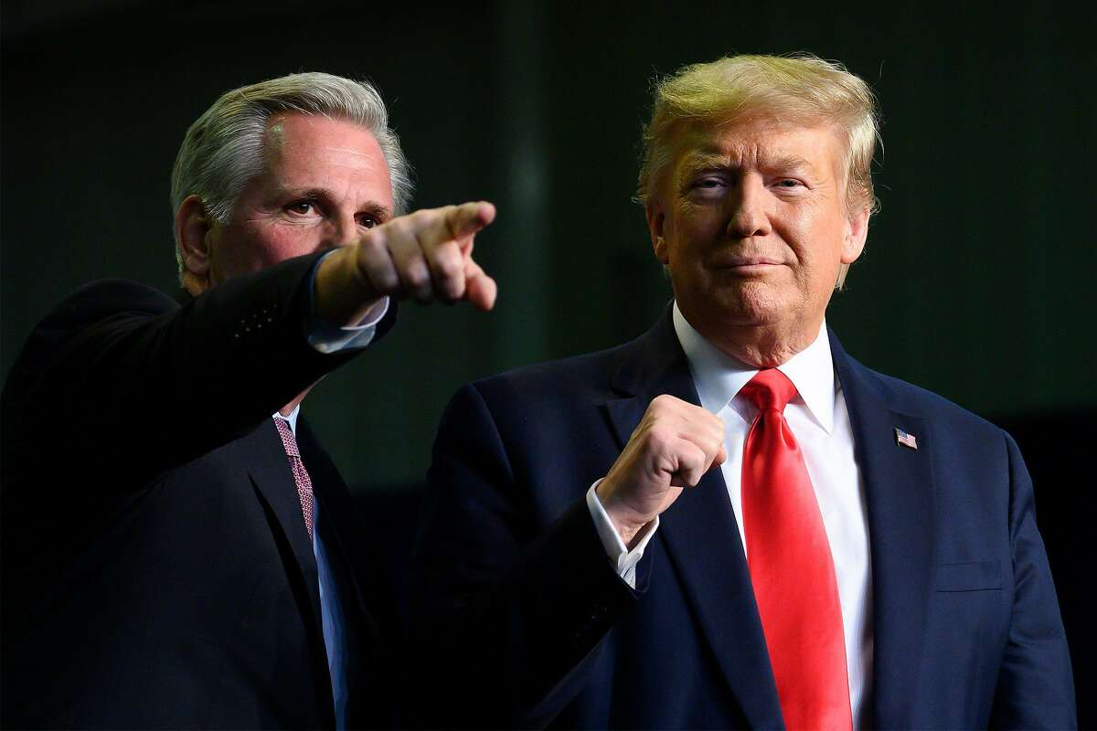 US President Donald Trump, right, gestures next to U.S. Rep. Kevin McCarthy as they deliver remarks to Rural Stakeholders on California Water Accessibility in Bakersfield, Calif., on Feb. 19, 2020. (Jim Watson/AFP/Getty Images/TNS)