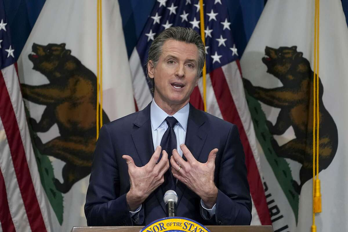 """FILE - In this Jan. 8, 2021, file photo, California Gov. Gavin Newsom outlines his 2021-2022 state budget proposal during a news conference in Sacramento, Calif. A scathing state audit released Jan. 28, 2021, blames Newsom's administration for """"significant missteps and inaction"""" that cost taxpayers at least $10.4 billion to unemployment insurance fraud. (AP Photo/Rich Pedroncelli, Pool, File)"""