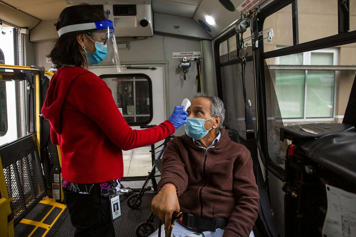 Brij Lal, a Fremont local, gets his temperature taken by nurse before entering the On Lok Pace Senior Center where he recieved his COVID-19 vaccine on Janurary 28, 2021.