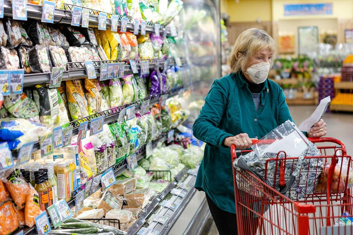 Doris Watkins wears a face mask while shopping for groceries at Trader Joe's on Friday, January 29, 2021, in San Francisco.